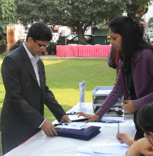 Mohammad Sahid Ullah at the Registration Desk of the Media Governance Conference, Jamia Millia Islamia